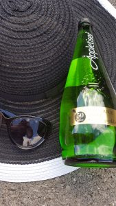 hat sunglasses and appletiser