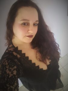me hair down in black lace dress