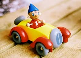 noddy in his yellow and red little toy car