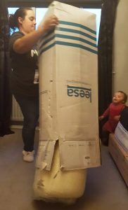 me tipping a mattress out of a box