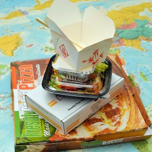 a stack of different takeaways on a map