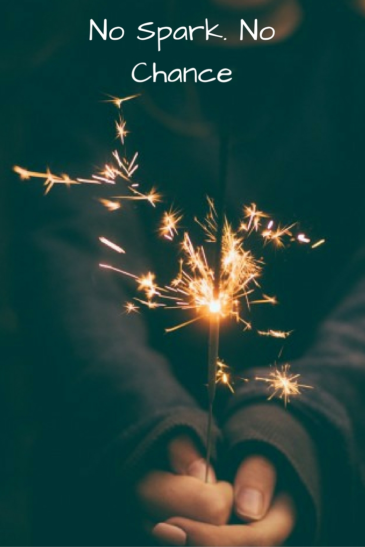hands holding a sparkler