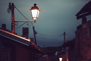 street lamp lit next to a roof