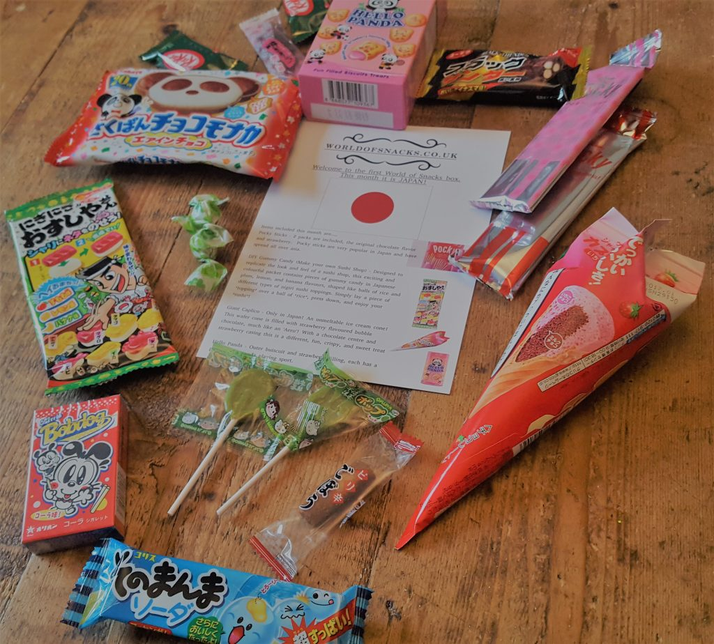 assortment of japanese snacks laid out on a table