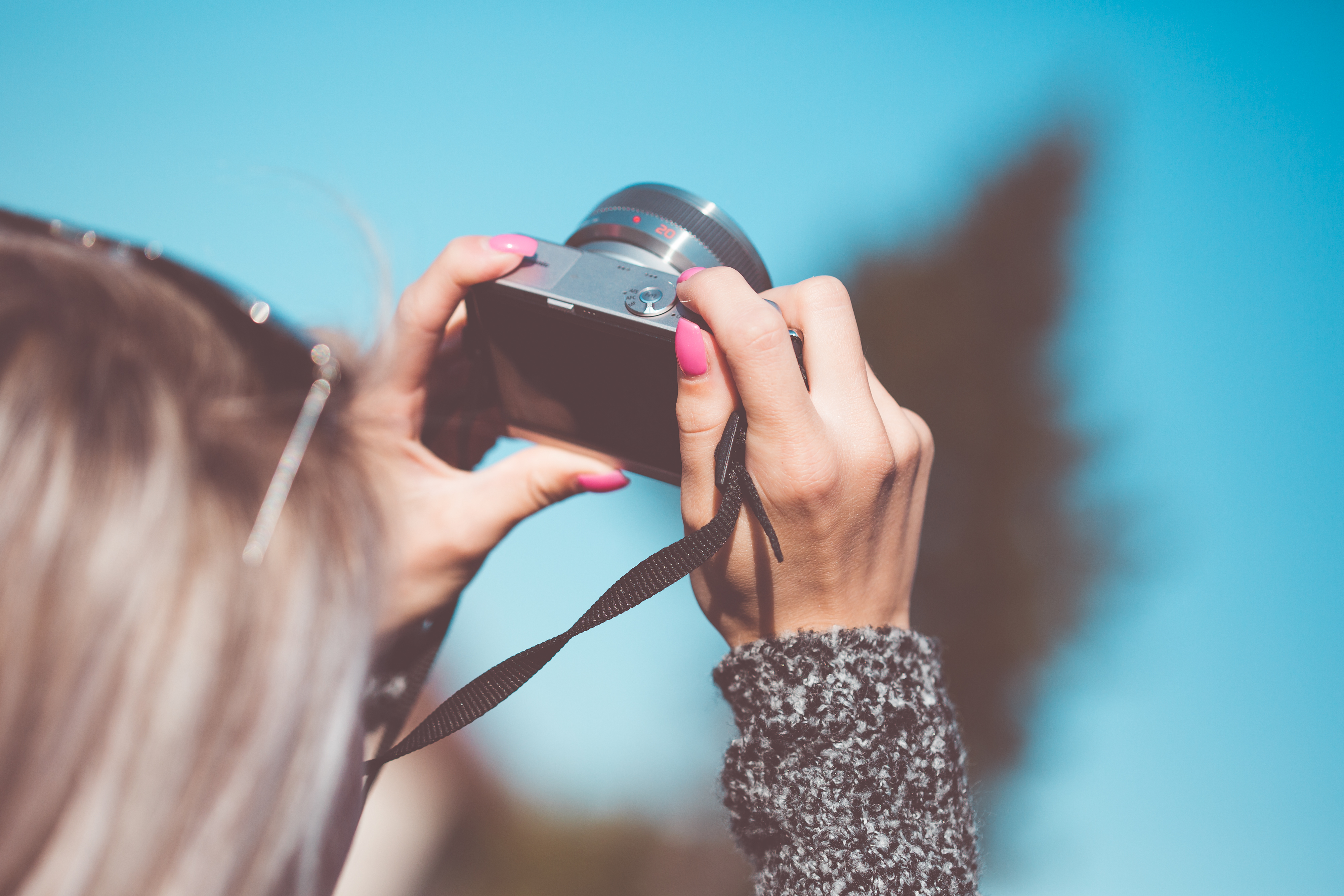 woman taking a picture with a blue background