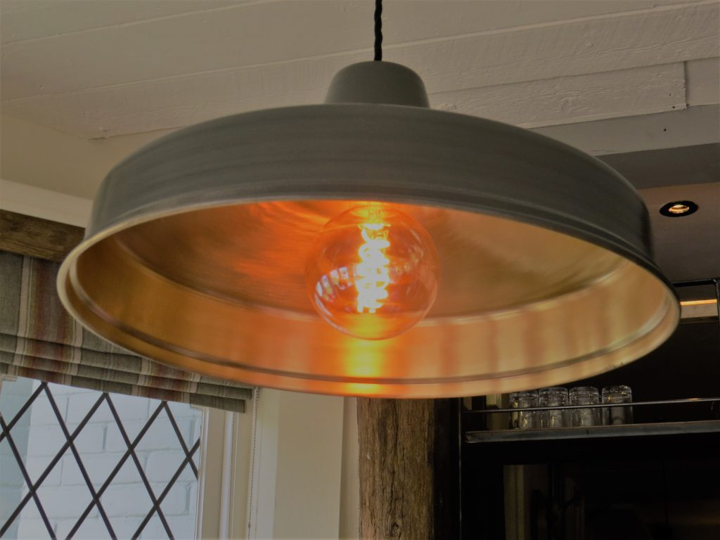 an industrial style hanging lamp fitting