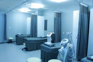 a row of hospital beds that are all clean and ready all grey