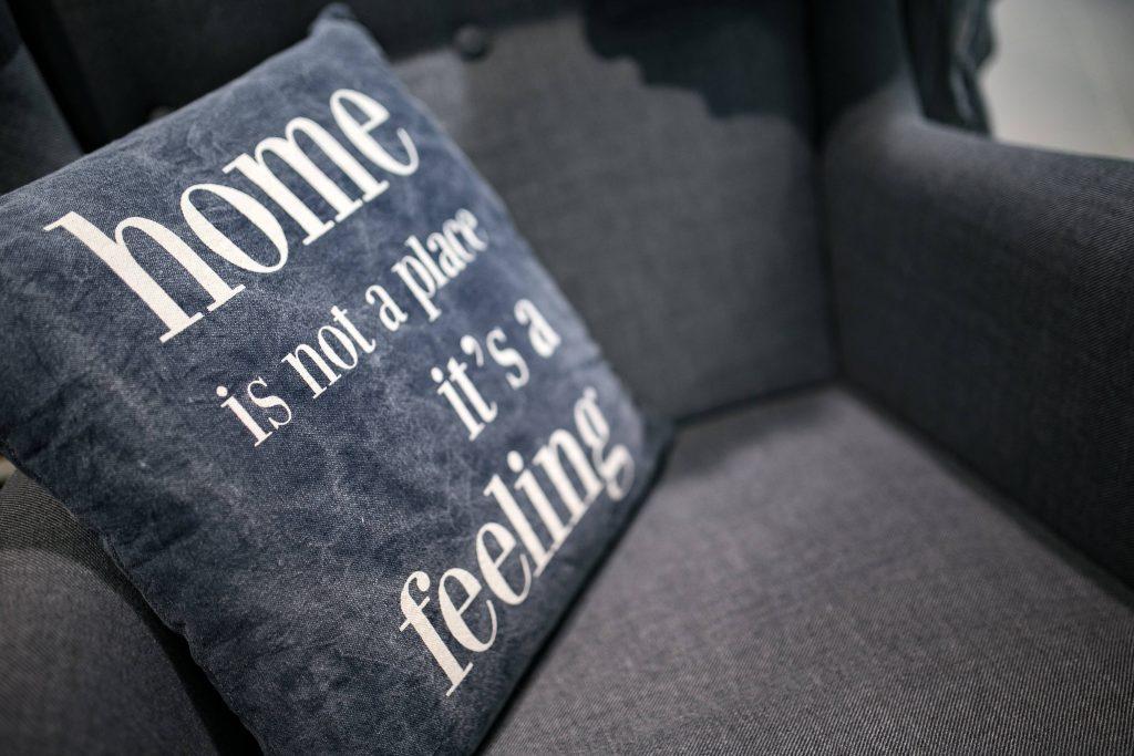 grey sofa with a blue cushion on it