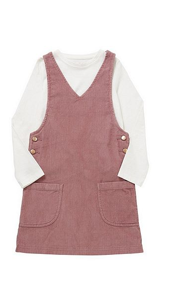 a pink corduroy dungarees dress with pockets on the front and a white long sleeved top underneath for a little girl