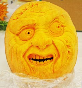 a pumpkin carved into the face of a monster