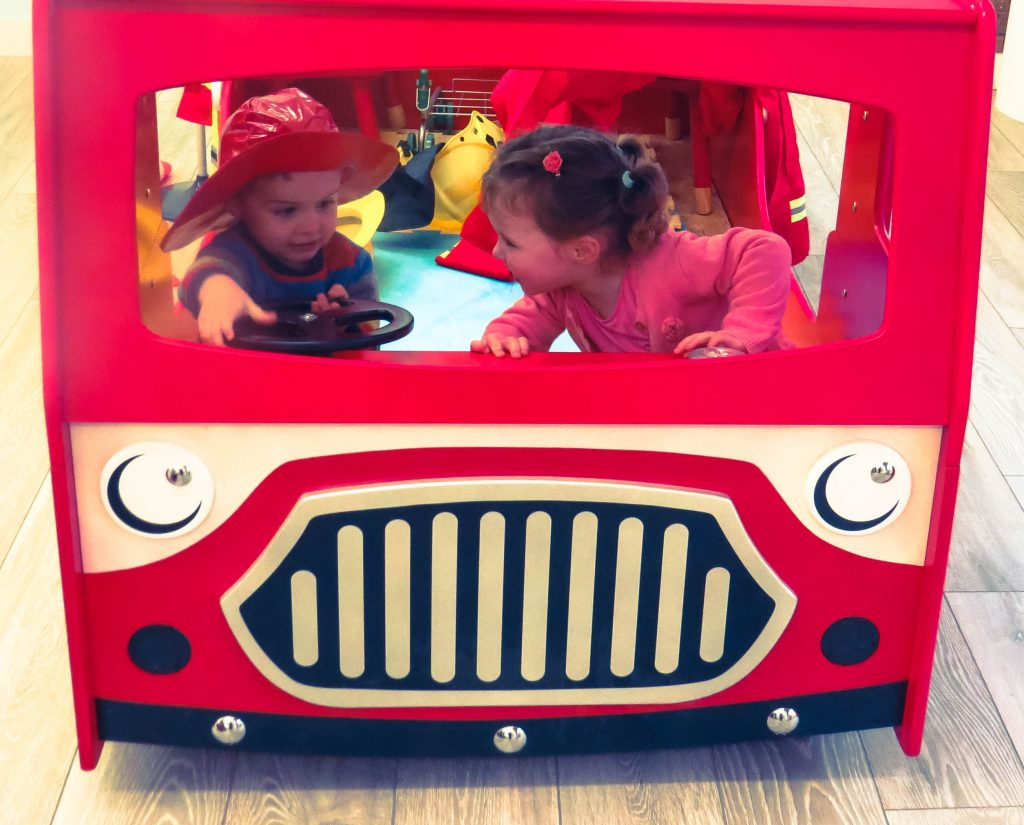 alyssa and l in red fire engine