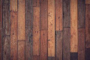 a top shot of darkish wooden floor boards