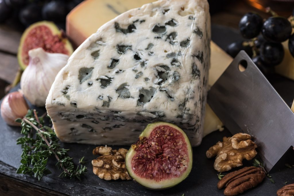 a plate of cheese and figs