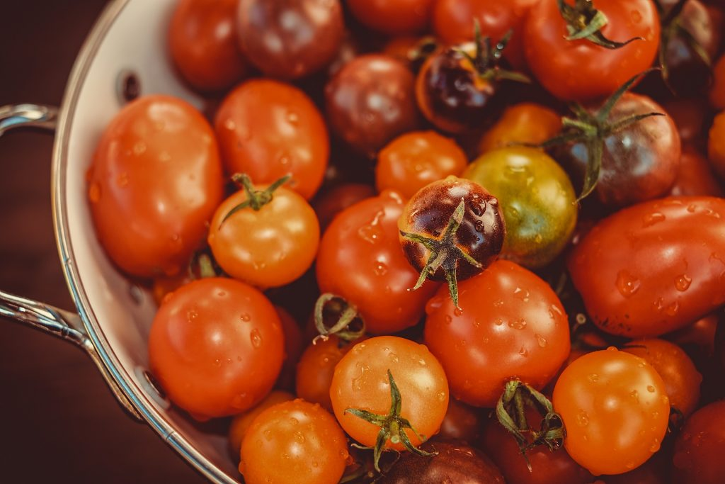 a bowl of different types of tomato