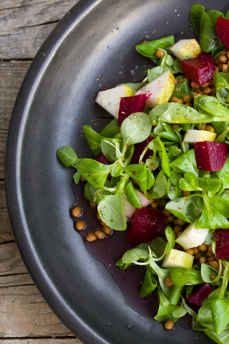 a beetroot and seed vegan cheese salad