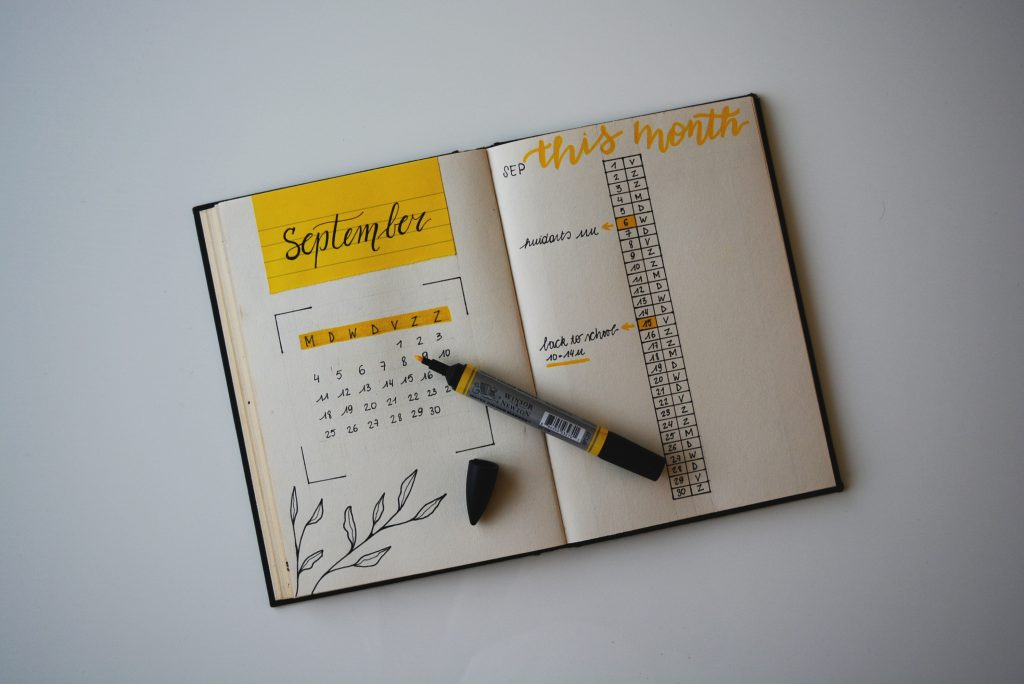 a journal open to september showing a month spread
