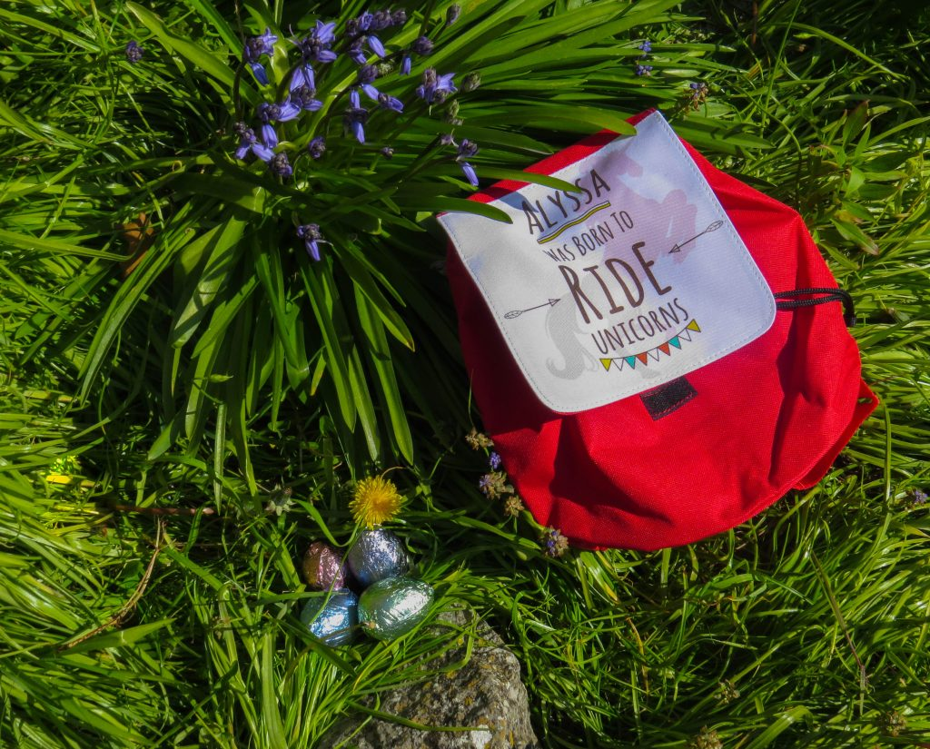 personalised unicorn backpack on grass