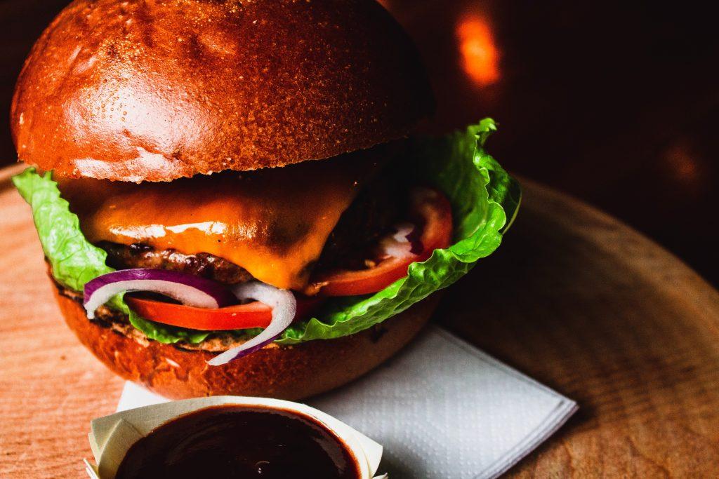 burger in a bun with sauce