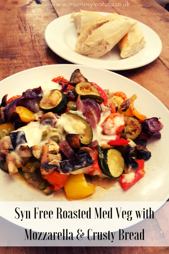 a plate of roasted med veg with mozzarella and some crusty bread