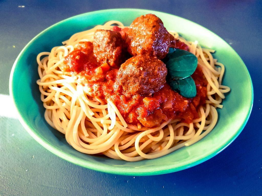 a bowl of vegetarian italian meatballs with spaghetti