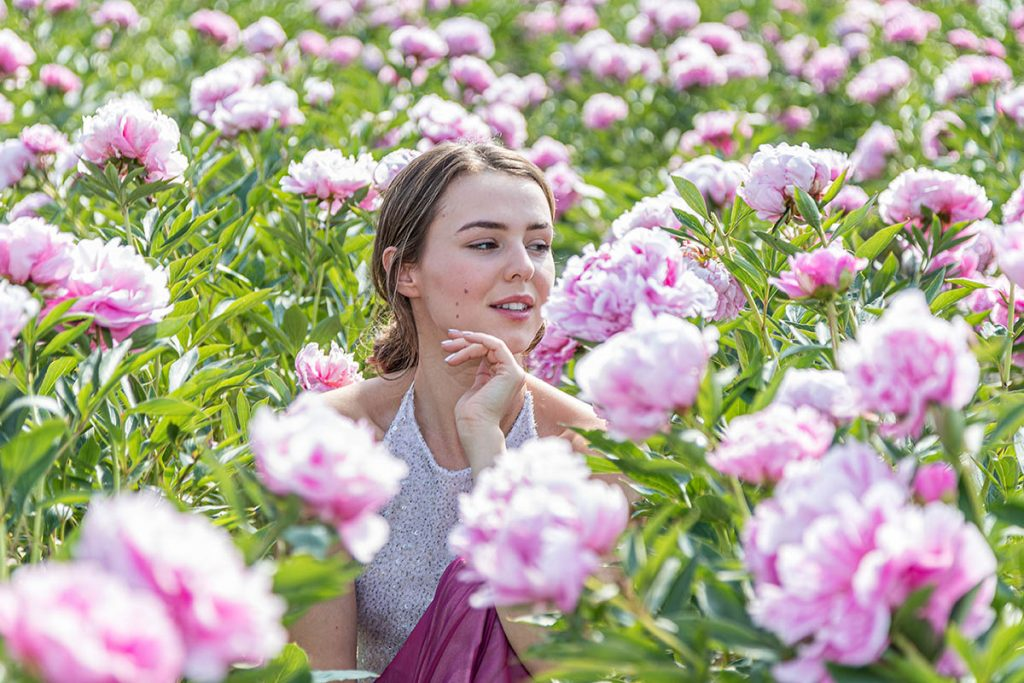Girl in field of pink Peonies - web