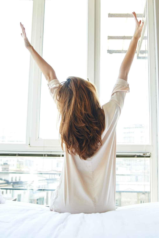 kick start your morning - woman stretching