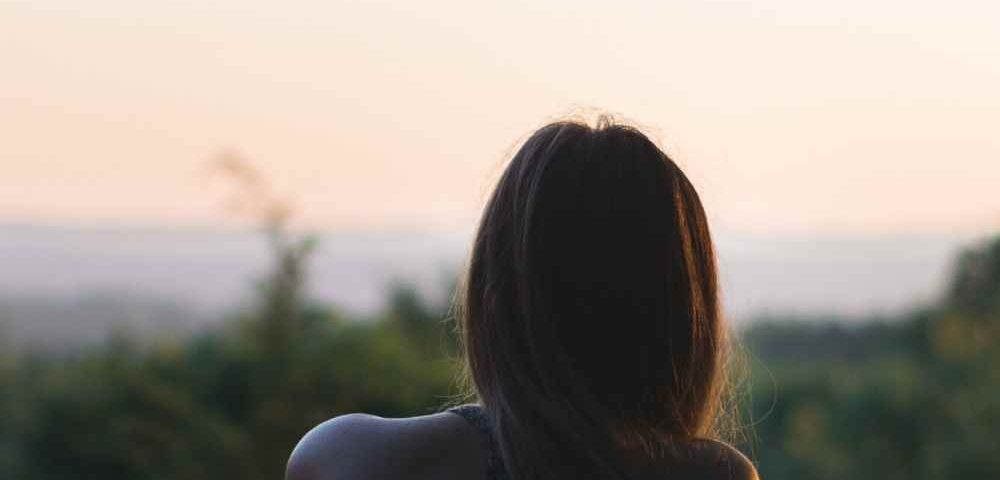 woman sitting looking out