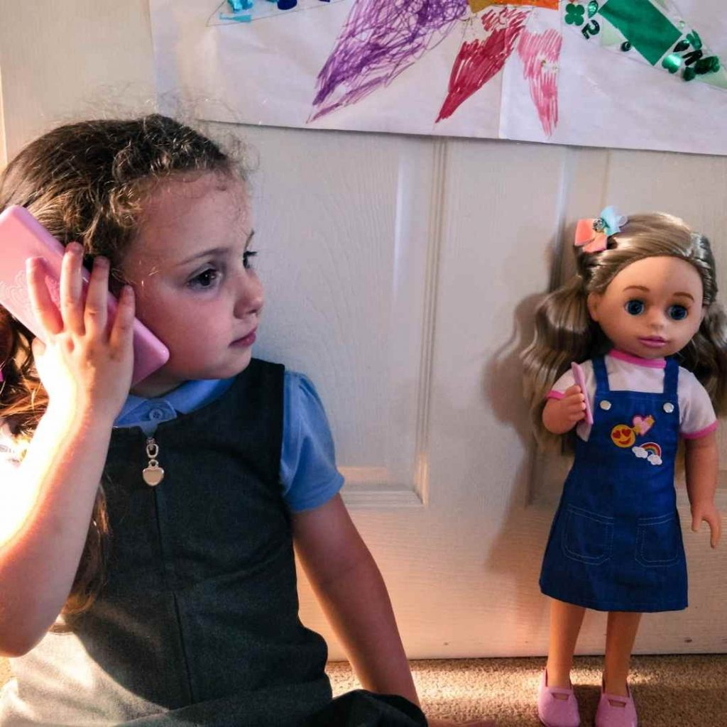 Alyssa calling the call me chloe doll on the phone