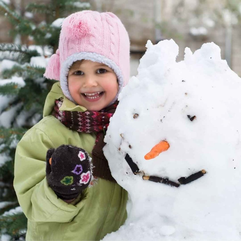 winter fun a child with a snow man