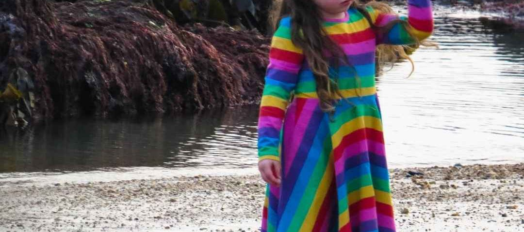 alyssa by the rockpools in her rainbow childrensalon dress
