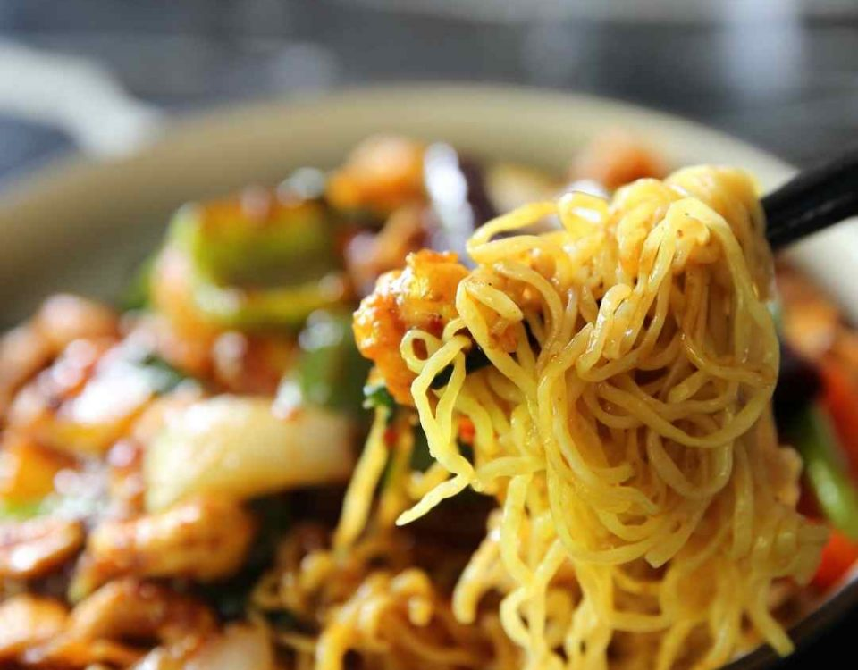 a bowl of chinese food with noodles