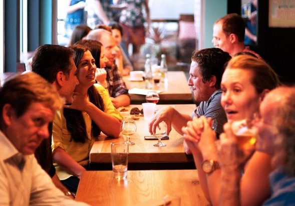 People talking in a crowded bar