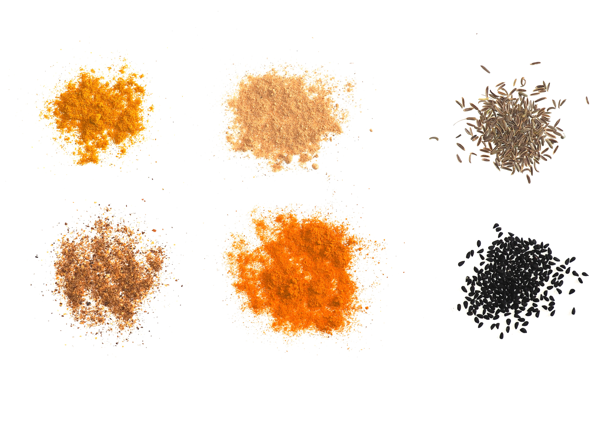 Many Indian and South American spices powder including Ginger Curry Turmeric Chili Pepper Black Cumin and Nigella Sativa over white background