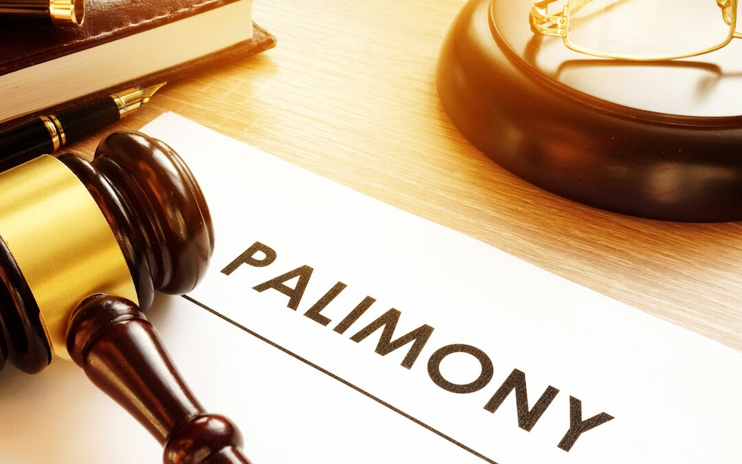 The word Palimony written on paper next to a judges hammer.