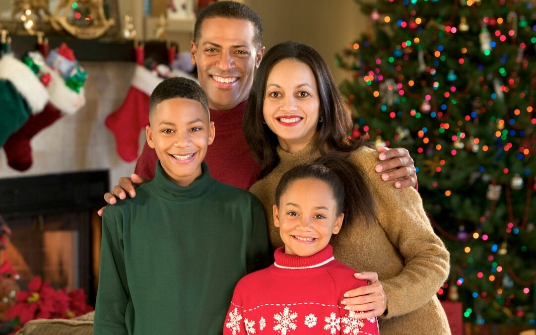 Christmas photo of a multicultural family with two kids.