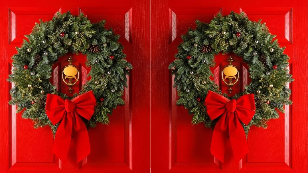 red doors with wreaths