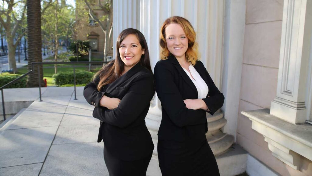 Natalie Gomez and Lauren Edwards standing on the courthouse steps.