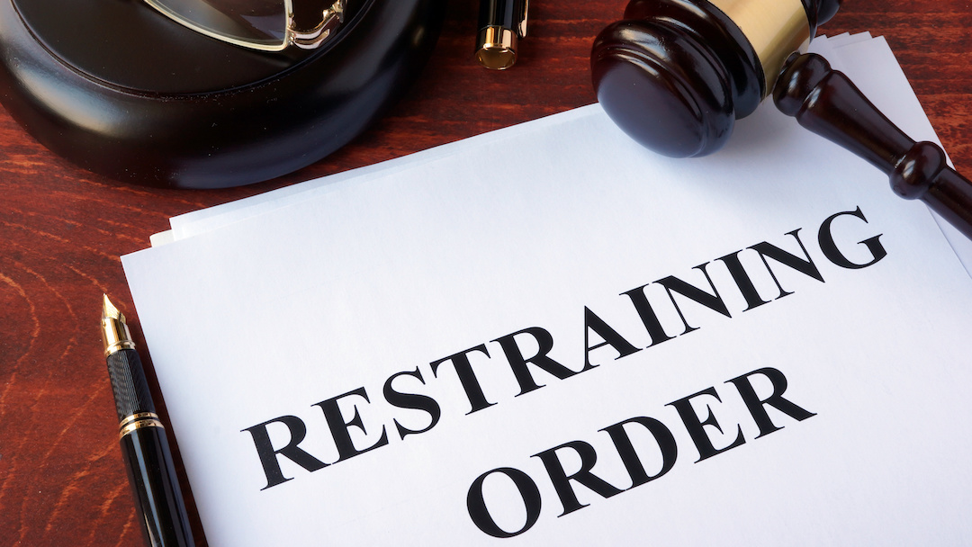 Restraining Order Papers and a Judges Gavel