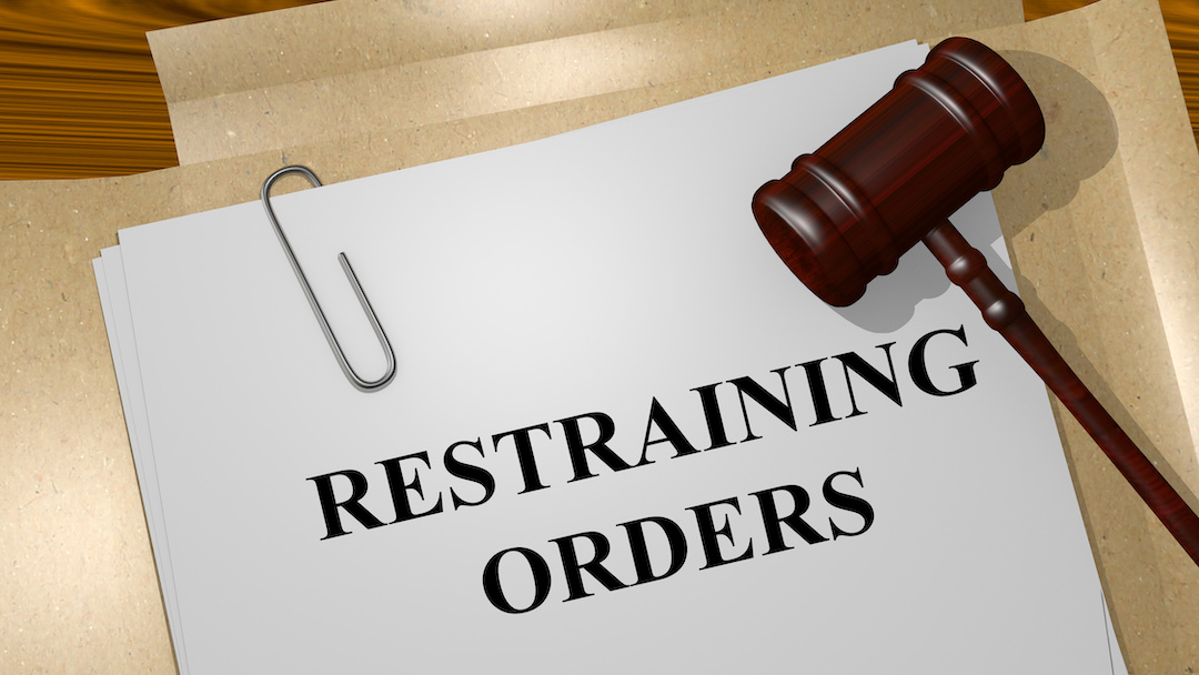 Paper that says restraining orders and a gavel