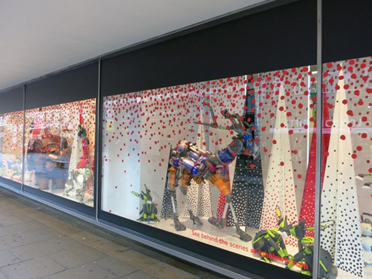 Cut vinyl graphics applied to window and window display elements