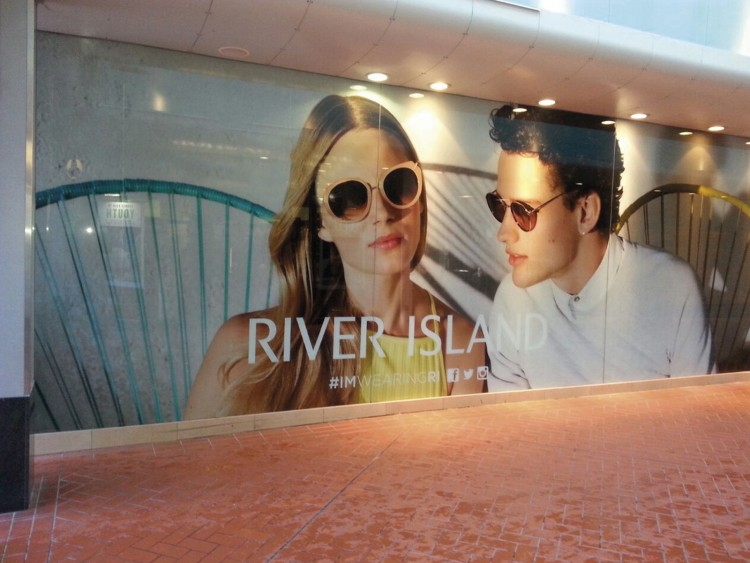 Large format window graphics are ideal for both short-term promotion and store branding