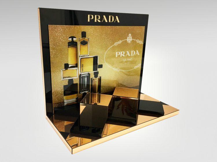 Colouration designed and produced this chic gold acrylic fragrance tester unit for Prada, a luxury display sure to enhance any cosmetics counter
