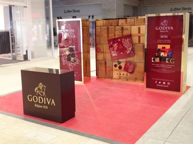 Christmas Pop-Up Site for Godiva Chocolates, featuring luxurious freestanding display units.