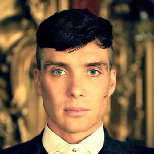 Tom Shelby Haircut Tom Shelby played by Cillian Murphy, is the crim boss with style. Although the character often wears a hat, and when he's not wearing a hat, his awesome haircut is on the full display. Considering the look is from 1920s, it looks just as good now, as it did hundred years ago. The haircut is a short crop with shaved sides and back. The undercut has longer hairs at the top. the texture with layers and a natural wave. His style creates a short fringe that swoops across his forehead.