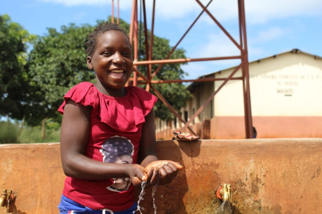 Sara Fransisco at the water point at Marera Primary school, Mazambique