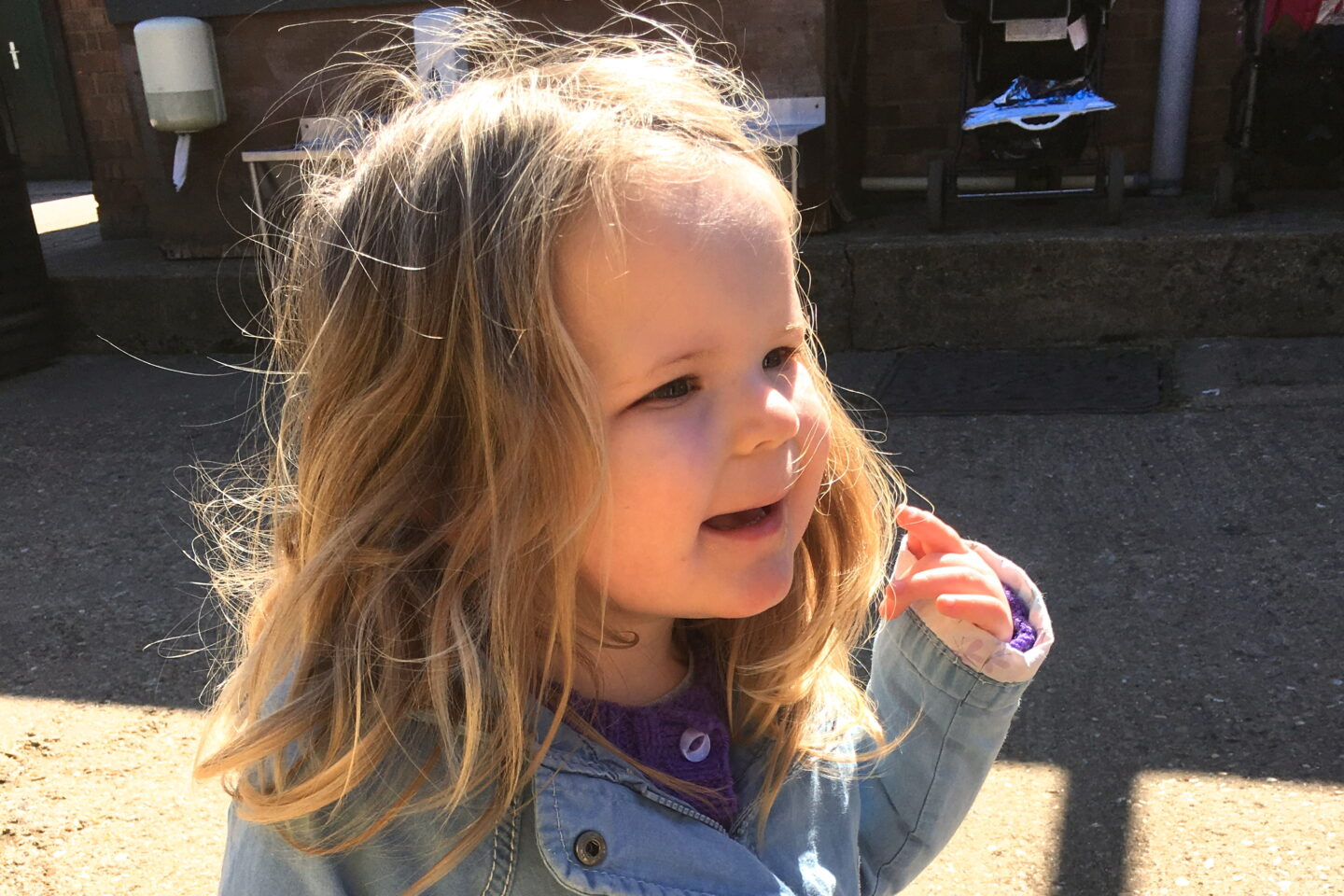 Toddler with SEN diagnosis, looking up and smiling