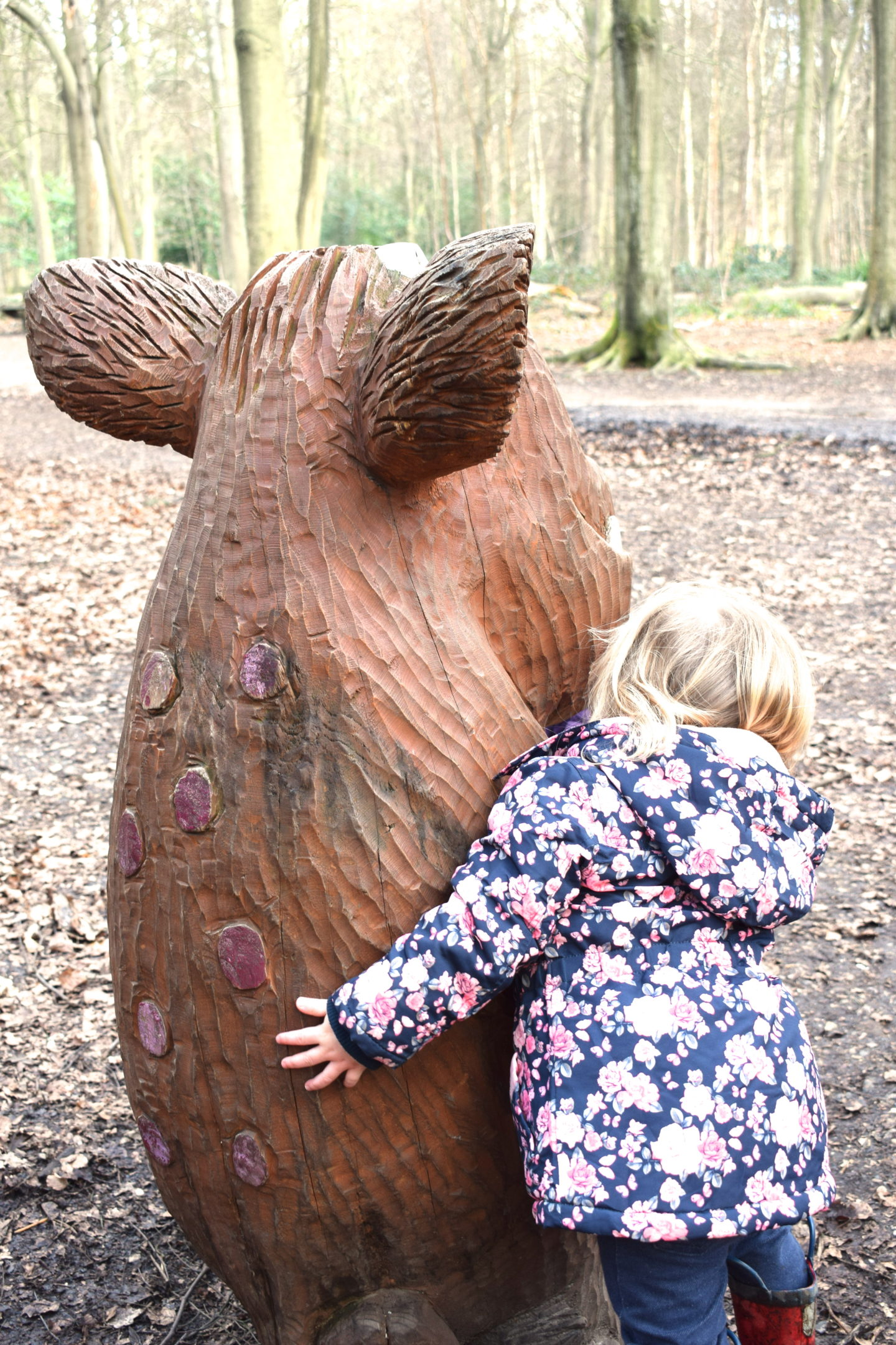 The Gruffalo Trail, Essex, Gruffalo's Child from behind with little girl cuddling it