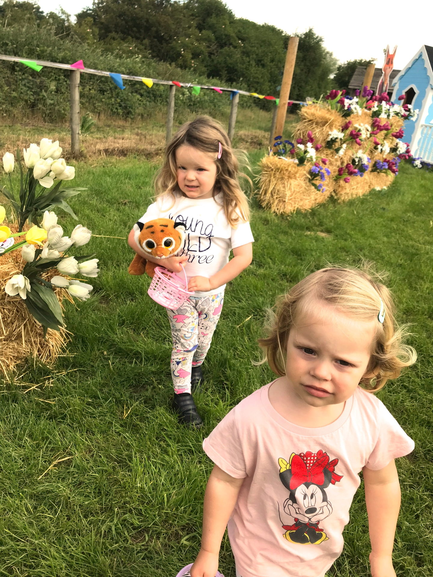Two sisters on a treasure hunt at Willows Activity Farm, Herts
