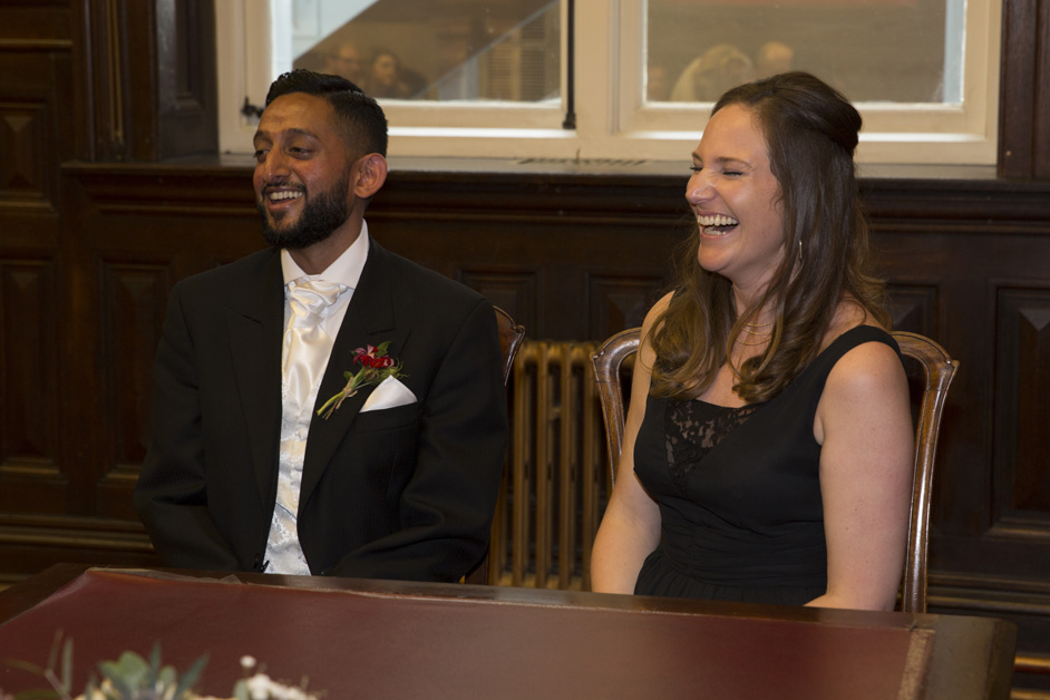 witnesses laughing during wedding ceremony at Bristol Register Office