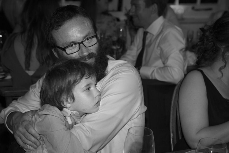 father holding and hugging his son during speeches at Bristol wedding reception at The Ethicurean